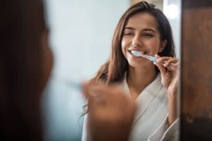 brushing and flossing teeth